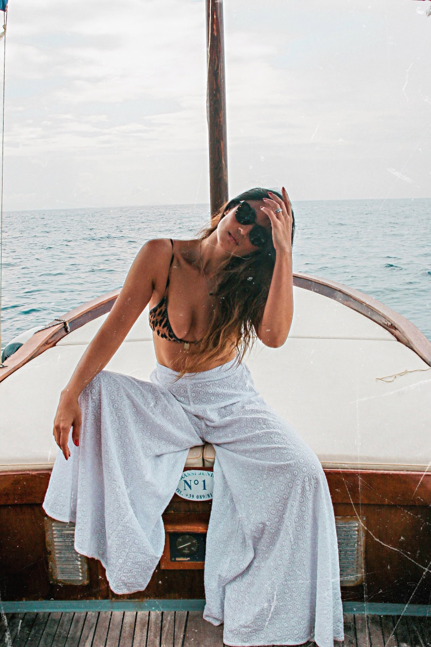 Wellness influencer Bianca Cheah hiring a boat in Positano